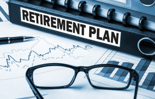Retirement-plan-with-graphs-and-glasses-on-desk