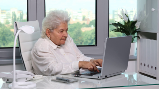 One-senior-female-working-on-computer-old-woman-typing-laptop-home-office-room_rmmxbdwn0_thumbnail-full01